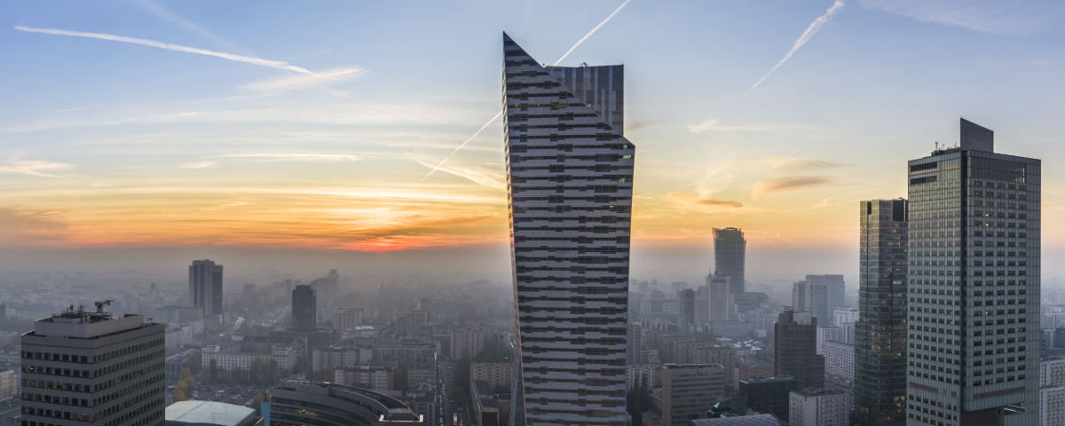 Panorama of foggy sundown over Warsaw city, Poland